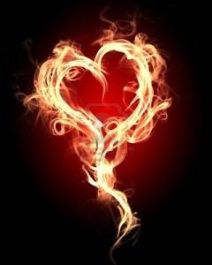 9349105-corazon-ardiente-con-llamas-contra-el-fondo-oscuro